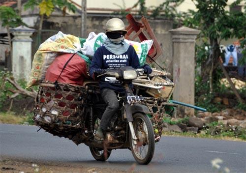 Bild: Bepacktes Motorrad mit Hausrat in Vietnam
