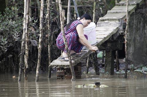 Bild: Waschen im Mekong