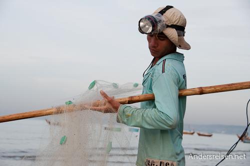Bild: Fischer mit seinem Netz in Mui Ne - Vietnam