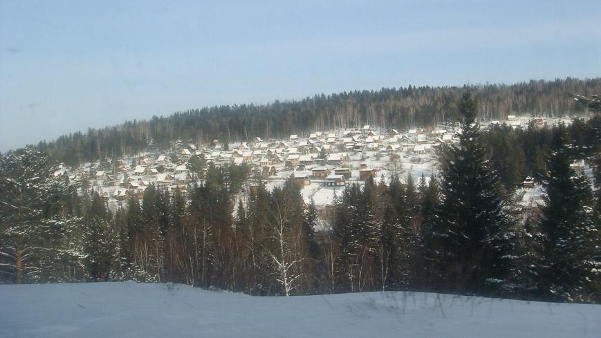 Bild: Holzhäuser entlang der Transsib